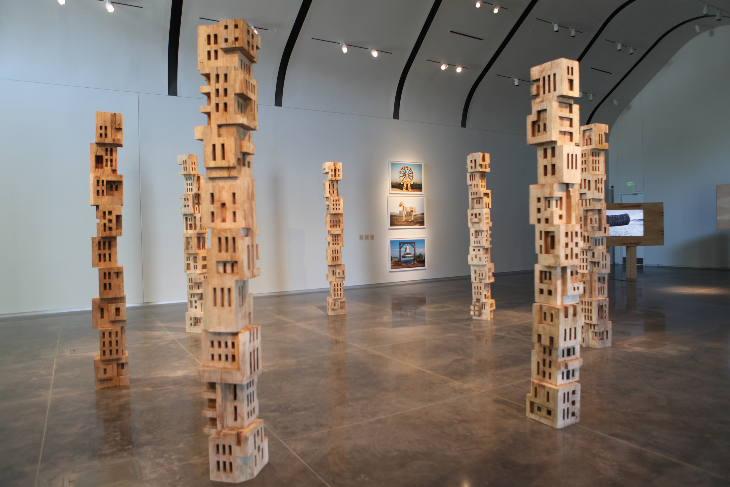 Gigi Scaria, 'Woodhenge', 2016, wood, paint, glue, 144 in each (7 poles). Image courtesy the artist.