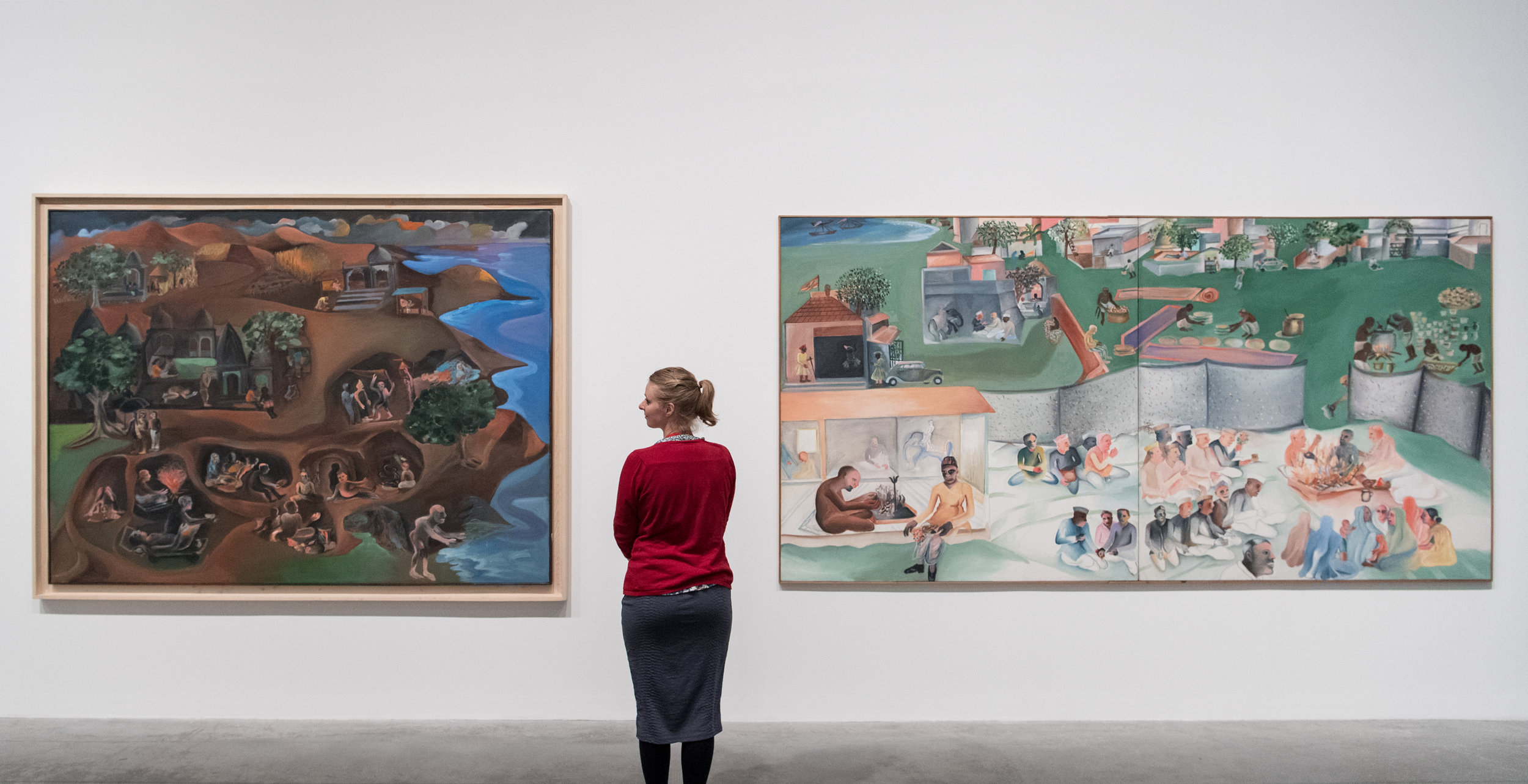 "Bhupen Khakhar, ""You Can't Please All"", Tate Modern, 2016, installation view. Left to right: 'Jatra', 1997–9, oil paint on canvas, 177.5 x 239 cm; 'Yagnya or Marriage', 2000, diptych: oil paint on canvas, 173.5 x 346.6 cm. Image courtesy Tate Modern."