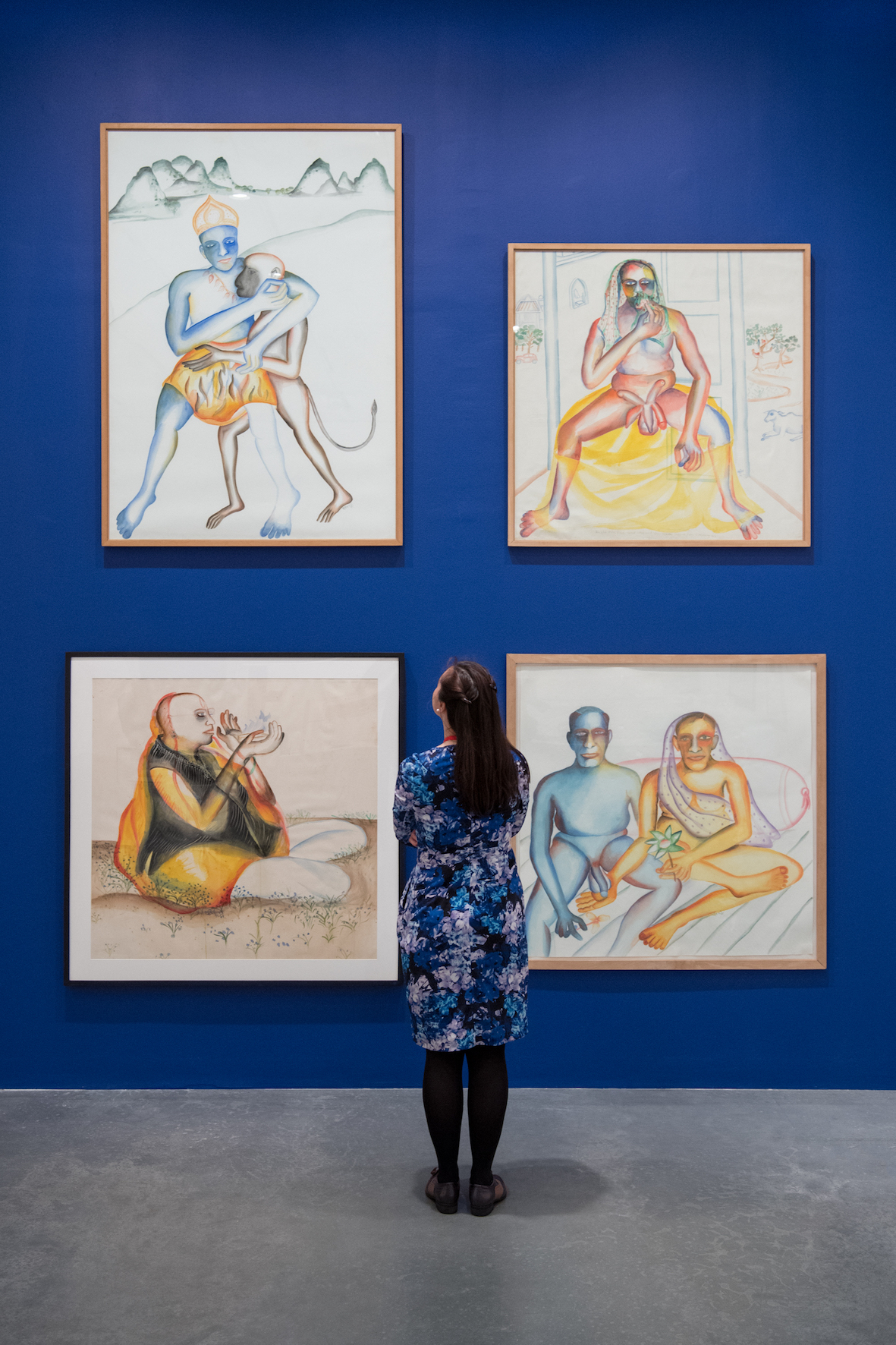 "Bhupen Khakhar, ""You Can't Please All"", Tate Modern, 2016, installation view. Clockwise from bottom left: 'Sakhibhav', 1995, watercolour on paper, 152 x 152 cm; 'Ram Bhakt Hanuman', 1998, watercolour son paper, 115 x 107.5 cm; 'An Old Man From Vasad Who Had Five Penises Suffered From A Running Nose', 1995, watercolour on paper, 102 x102 cm; 'Picture taken on their 30th Wedding Anniversary', 1998, watercolour on paper 110 x 110 cm. Image courtesy Tate Modern."