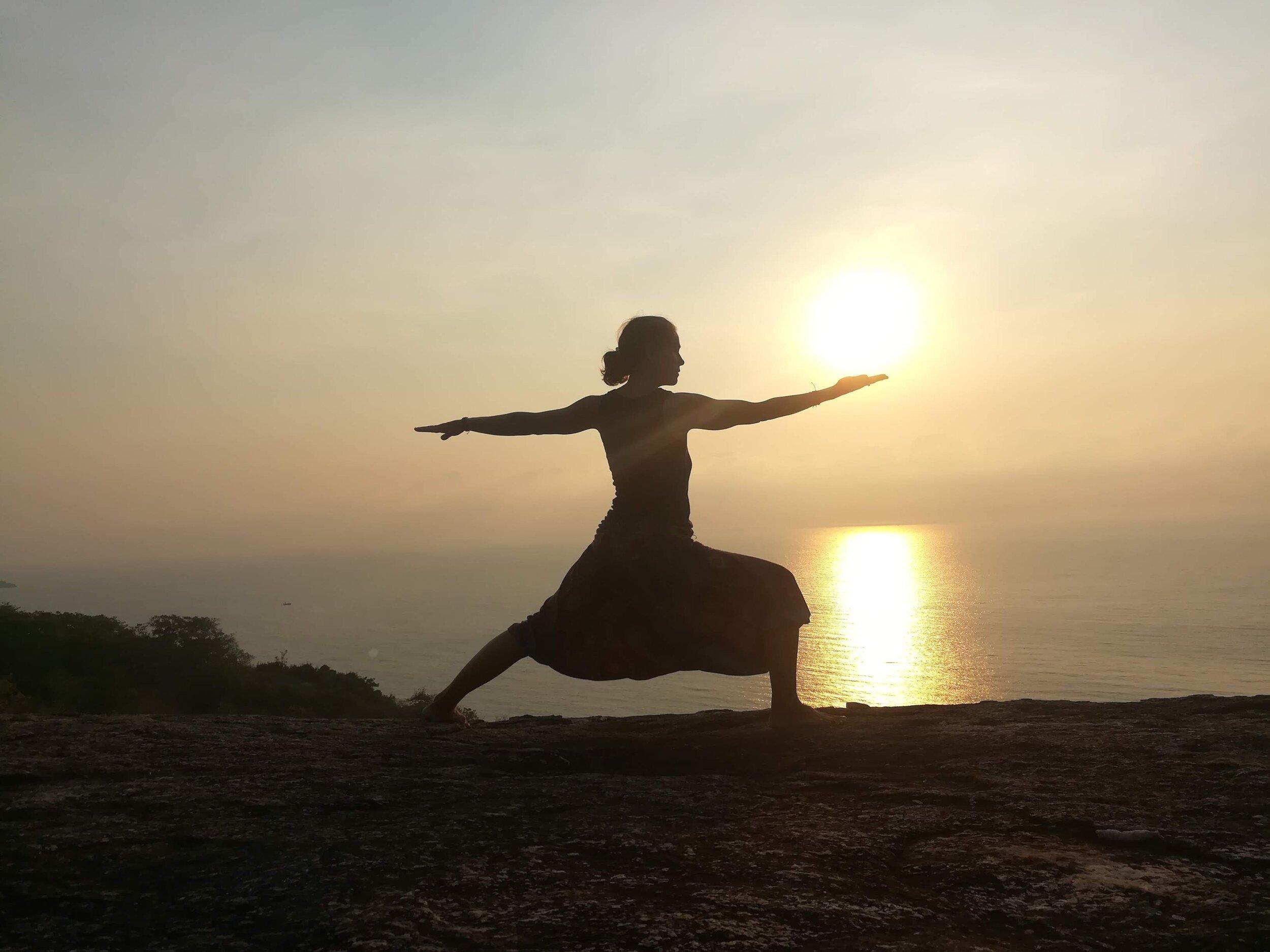 Olive Retreat Yoga warrior pose.jpg
