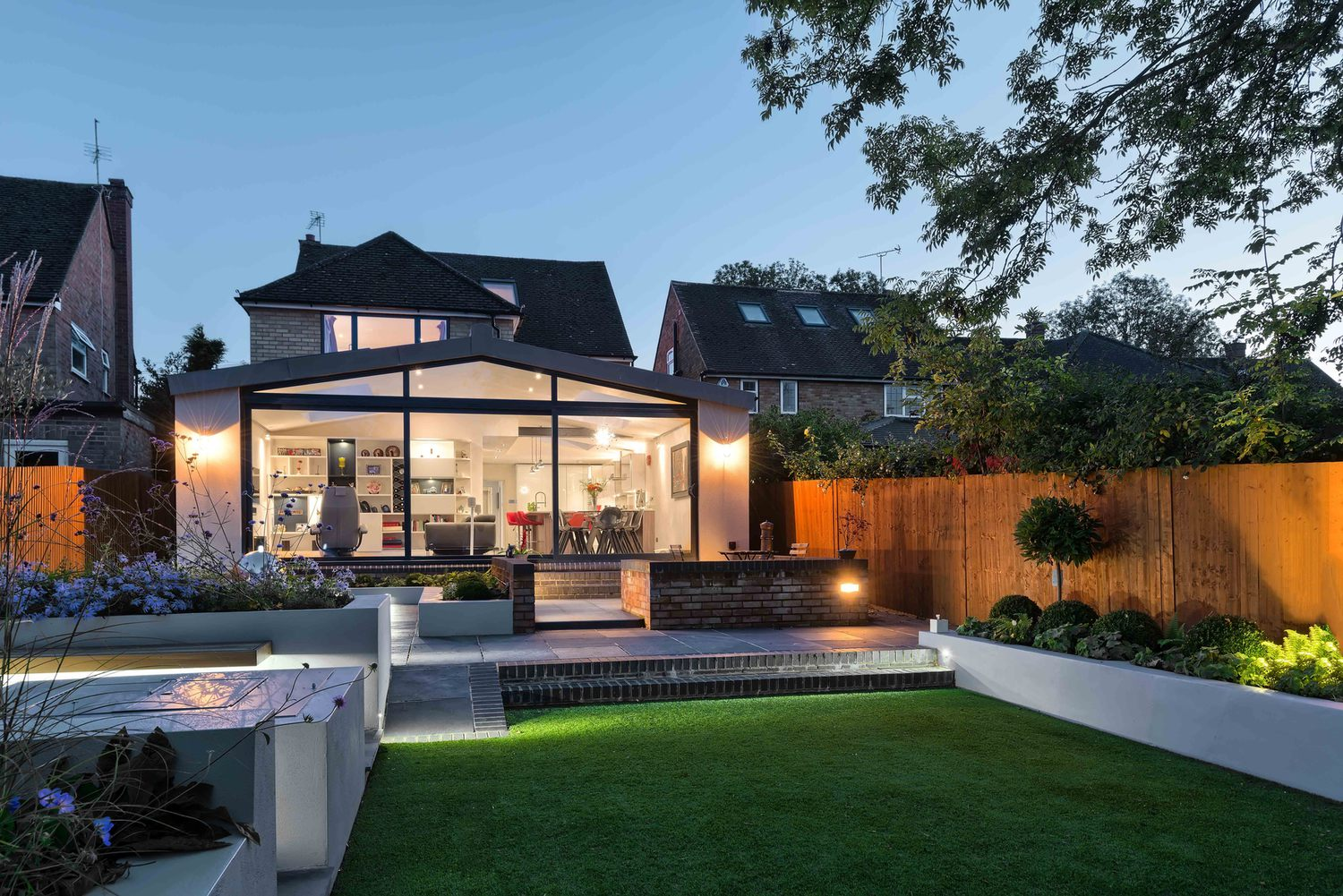 The garden view of a modern house extension by Harvey Norman Architects St Albans