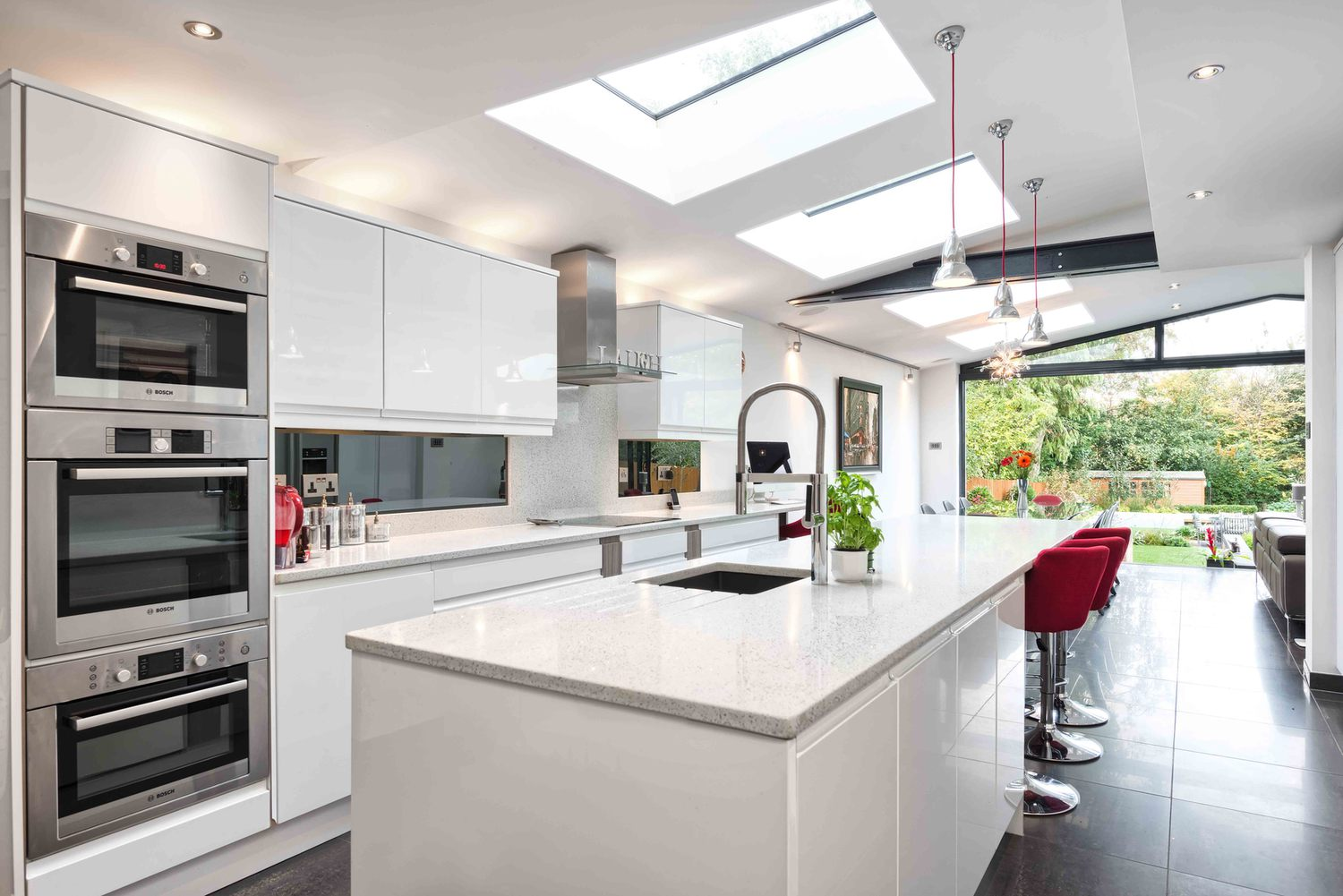 Kitchen view of a modern house extension by Harvey Norman Architects St Albans