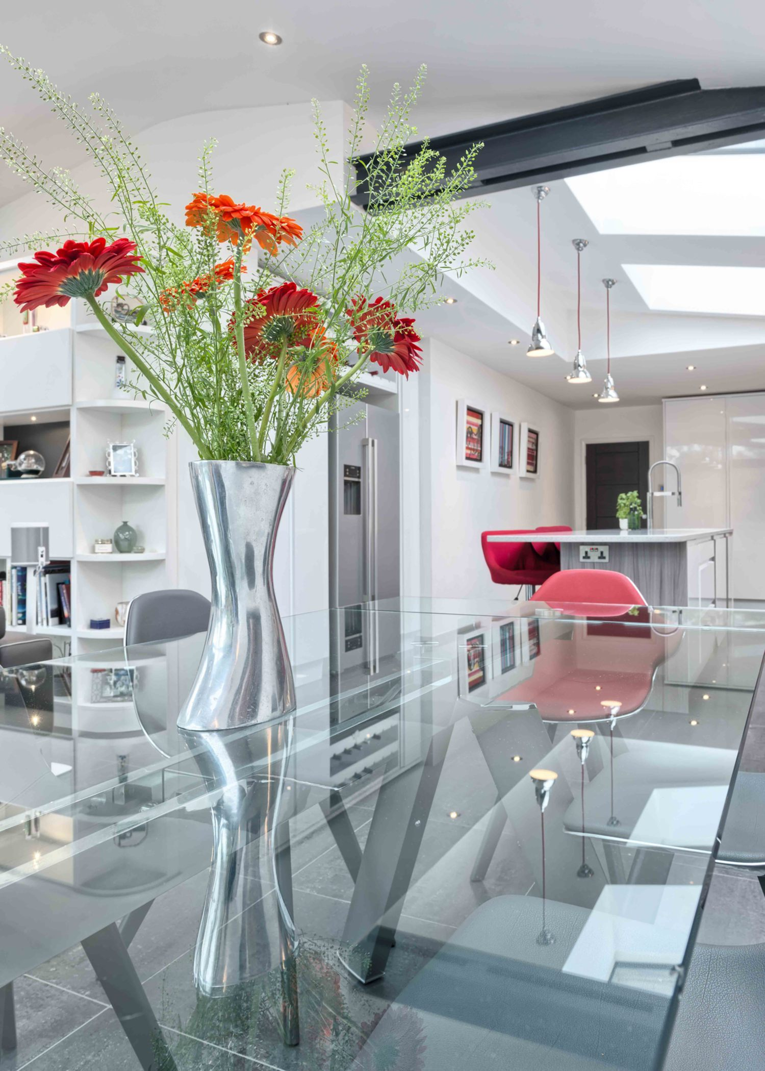 Glass dining room table of a modern house extension by Harvey Norman Architects St Albans