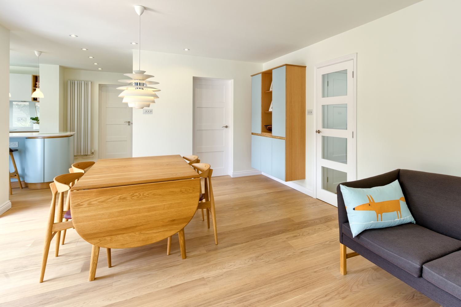 Dining area of a Scandinavian house extension by Harvey Norman Architects Bishop's Stortford