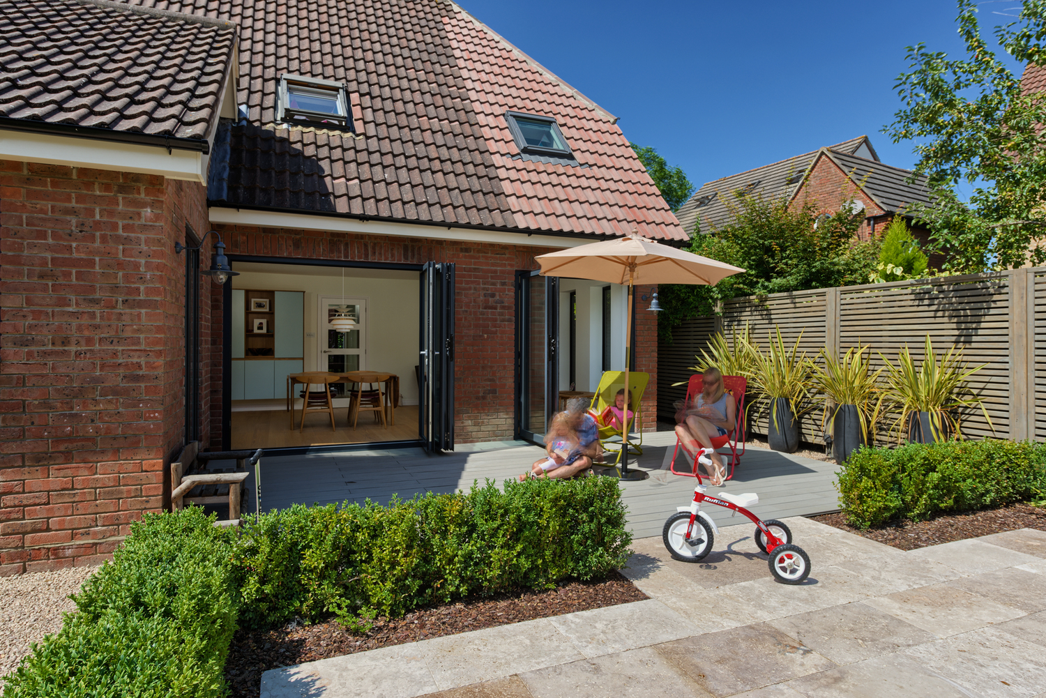 Garden view of a Scandinavian house extension by Harvey Norman Architects Bishop's Stortford