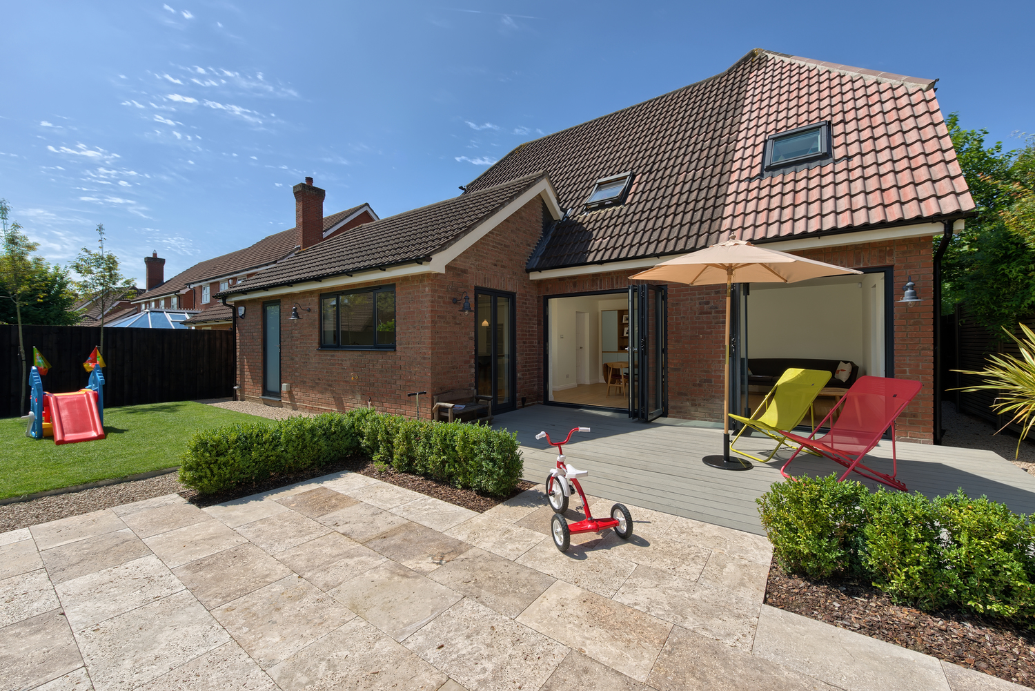 Garden pavement of a Scandinavian house extension by Harvey Norman Architects Bishop's Stortford