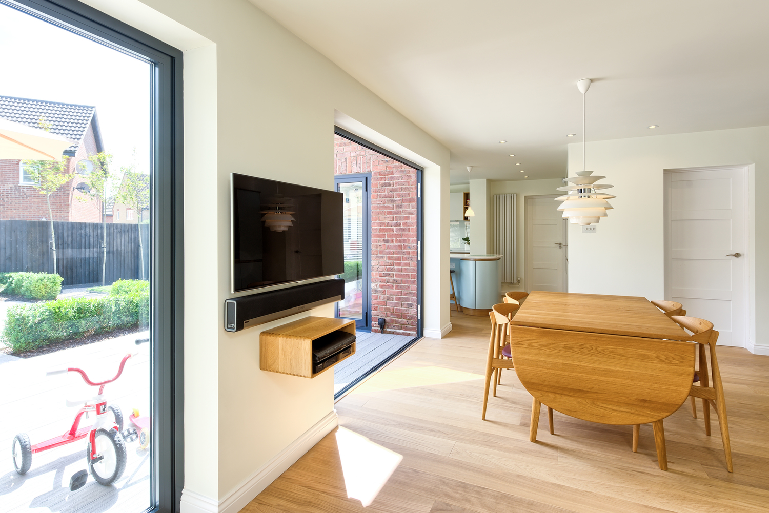 Glass door of a Scandinavian house extension by Harvey Norman Architects Bishop's Stortford