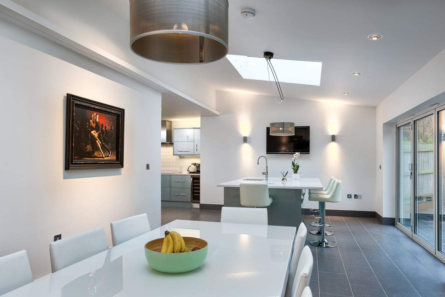 Dining room table and of a lighting house extension by Harvey Norman Architects Cambridge