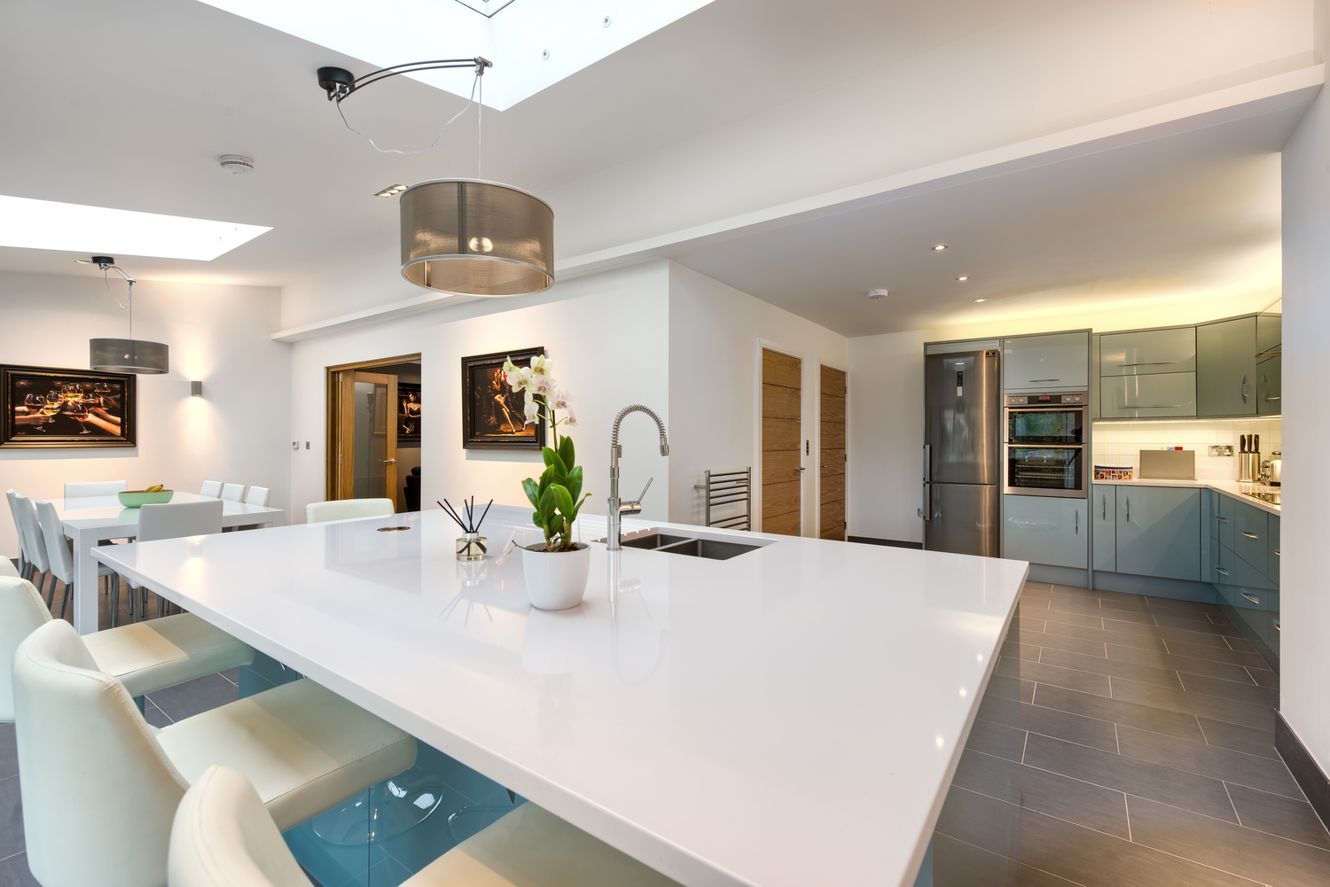 Kitchen view of a lighting house extension by Harvey Norman Architects Cambridge