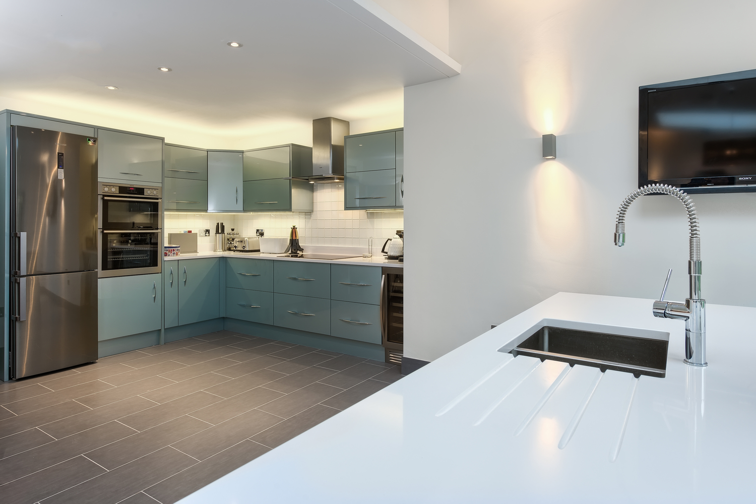 Kitchen sink of a lighting house extension by Harvey Norman Architects Cambridge