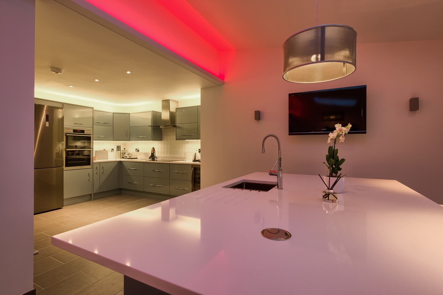 Breakfast table purple light of a lighting house extension by Harvey Norman Architects Cambridge
