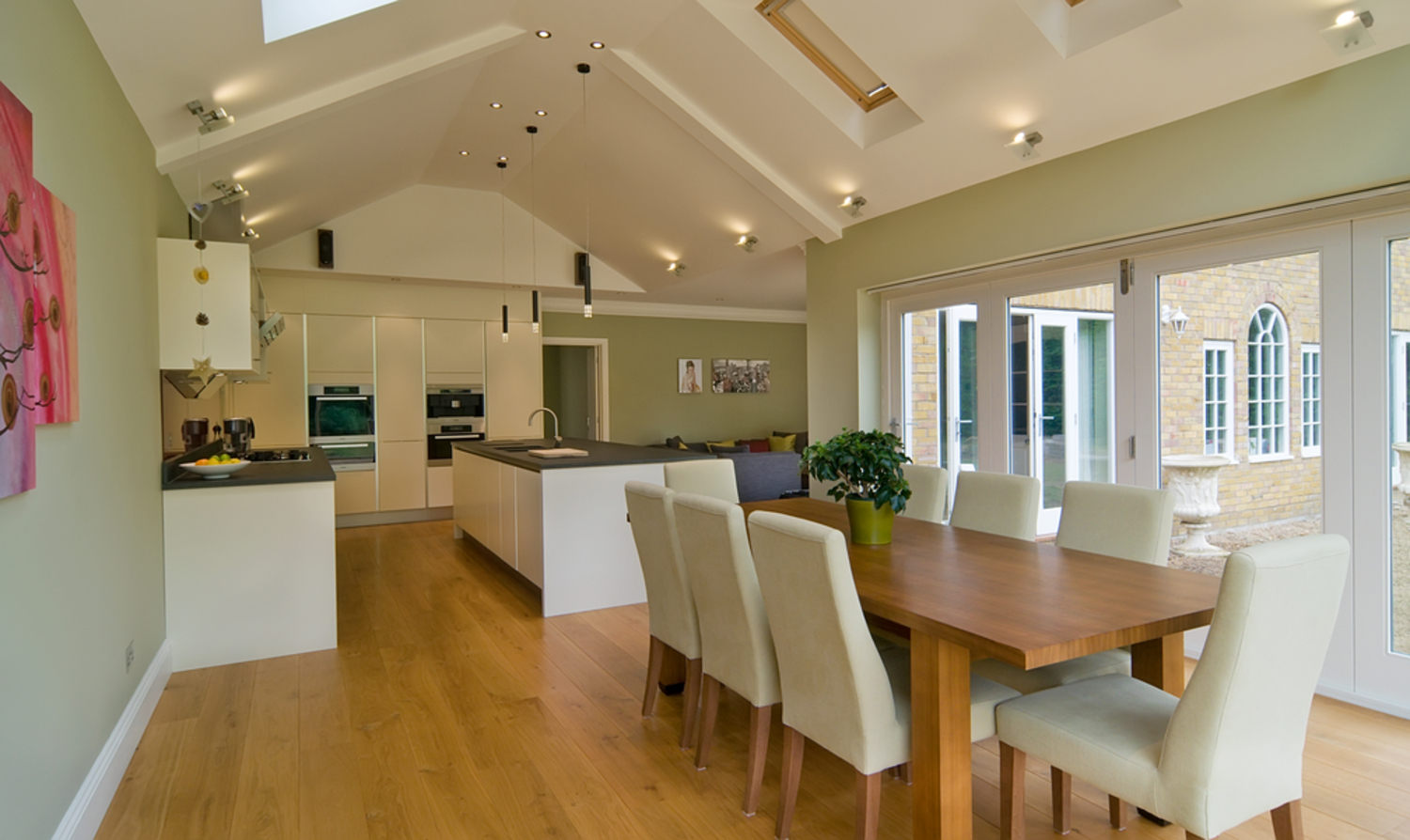 Dining room table kitchen view of a house extension by Harvey Norman Architects Cambridge