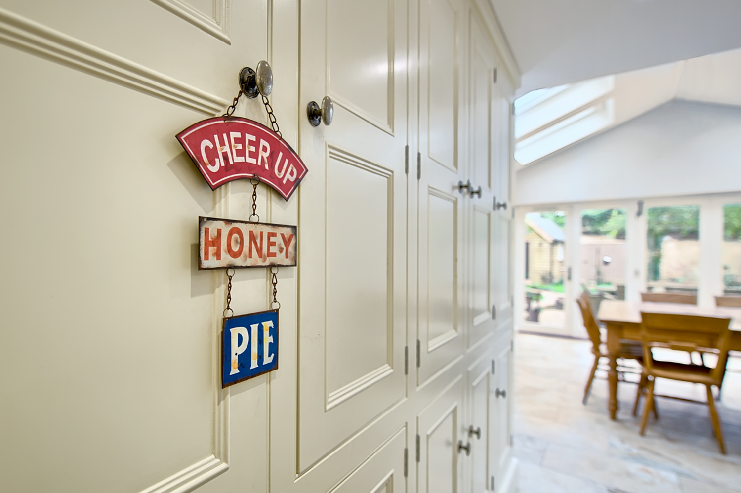 Kitchen cupboards hanged signs of a house redesign by Harvey Norman Architects Cambridge