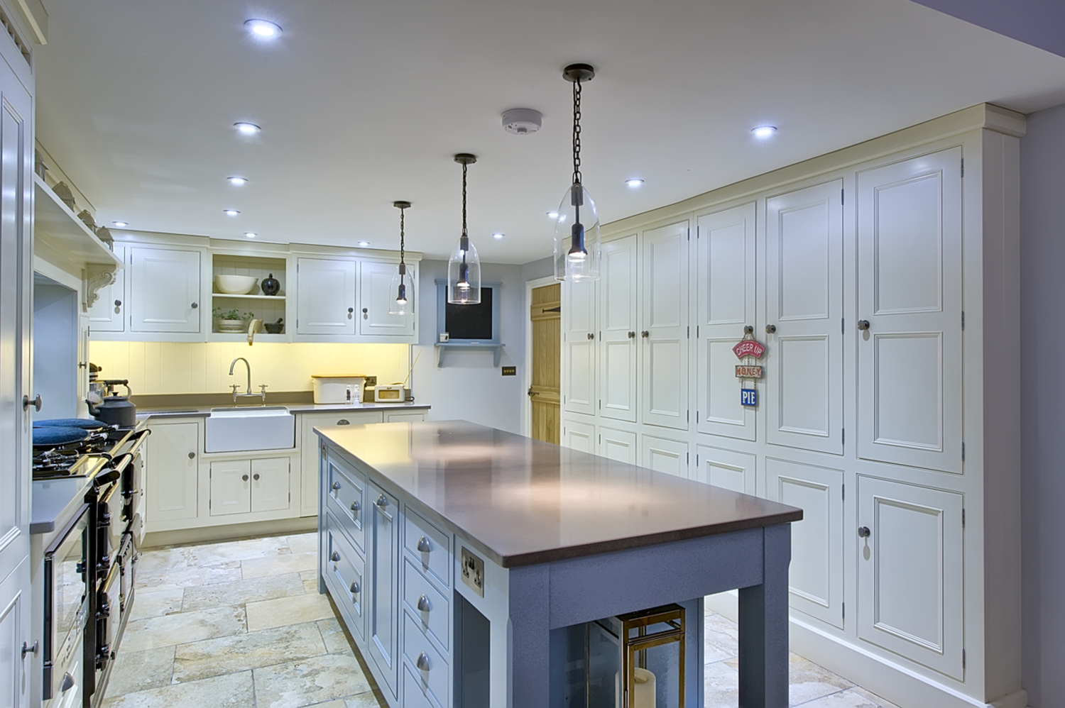 Kitchen island counter books of a house redesign by Harvey Norman Architects Cambridge