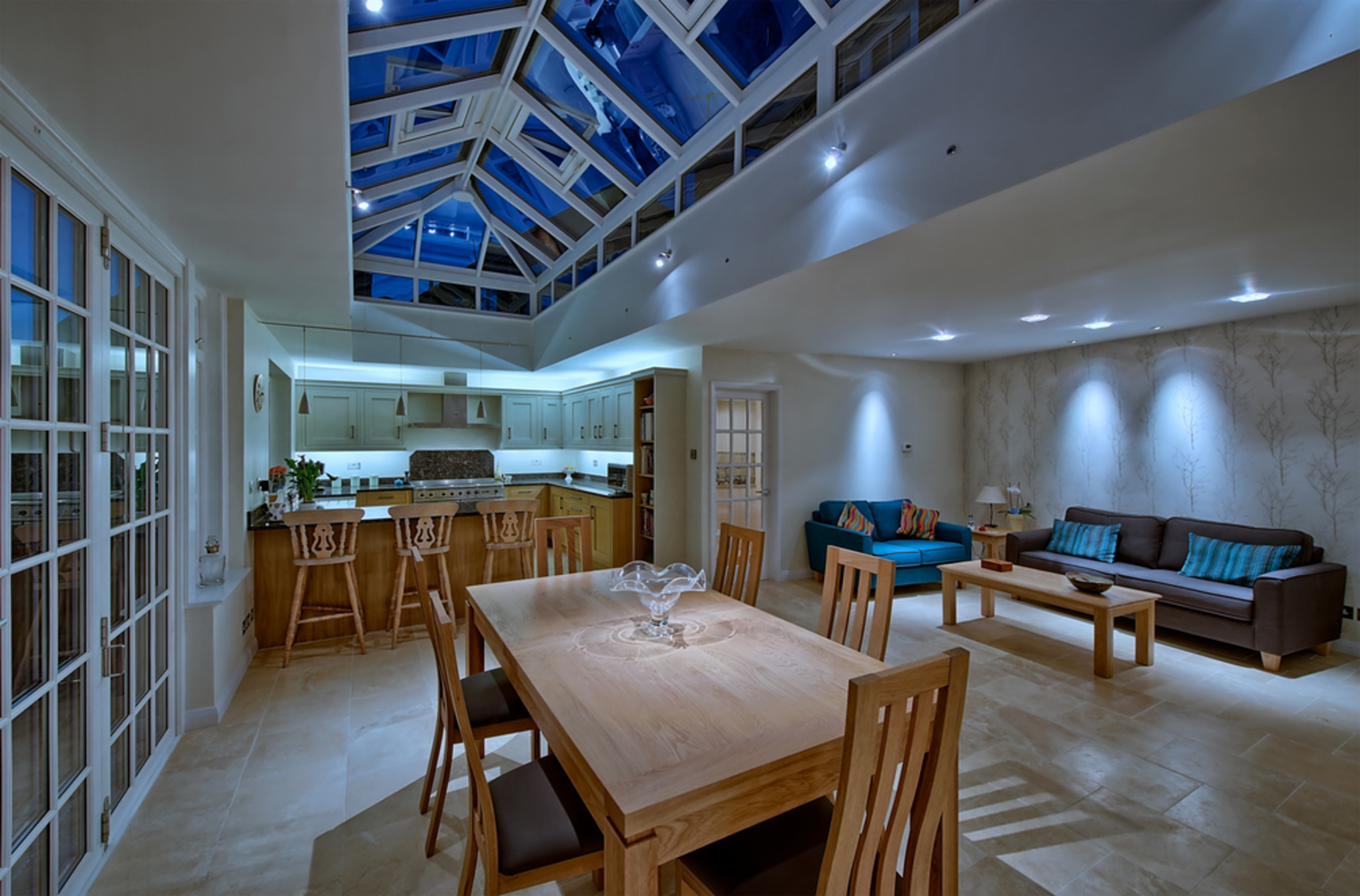 Dining room table night lighting of a house extension by Harvey Norman Architects St Albans