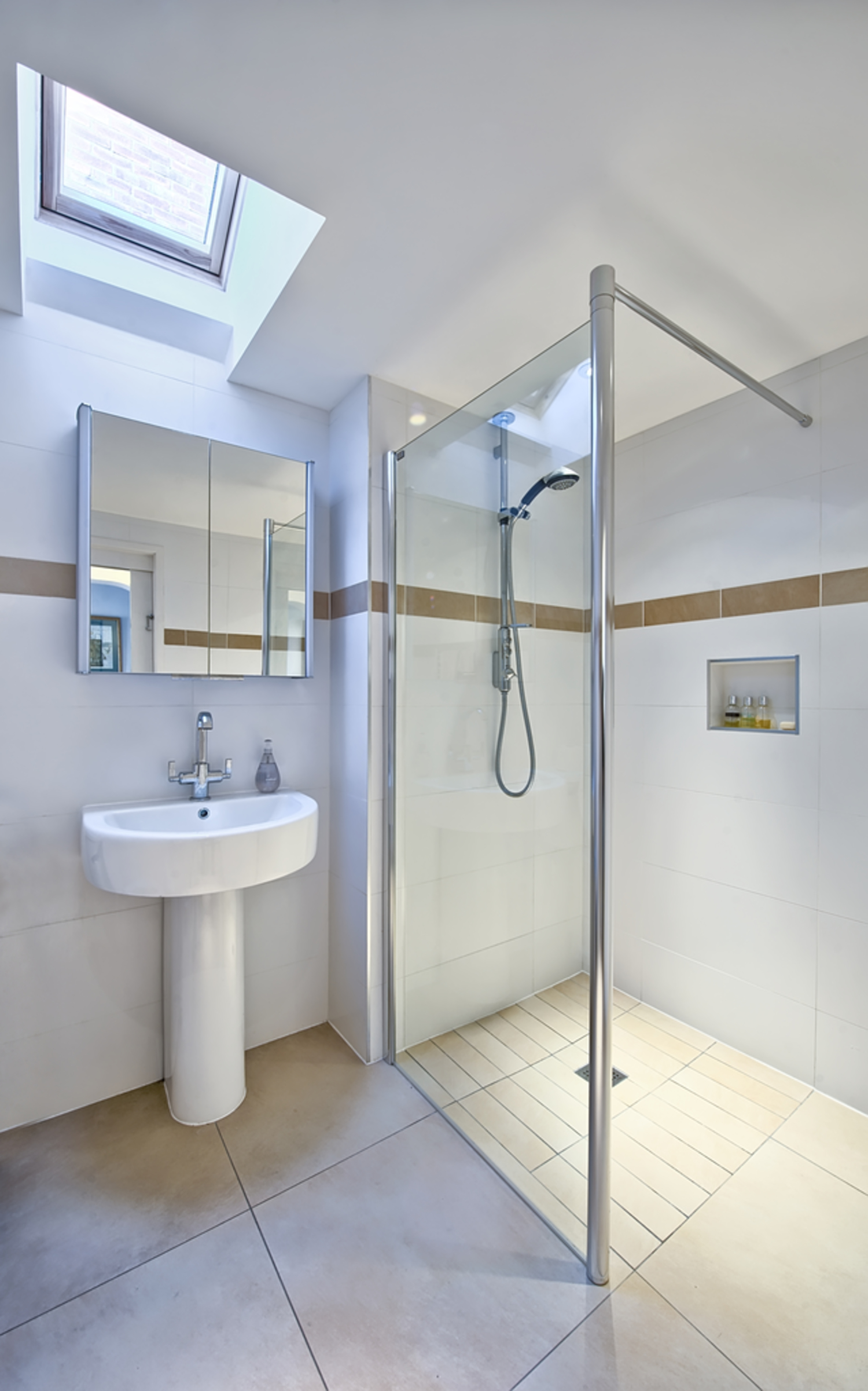 Modern bathroom shower of a house extension by Harvey Norman Architects Cambridge