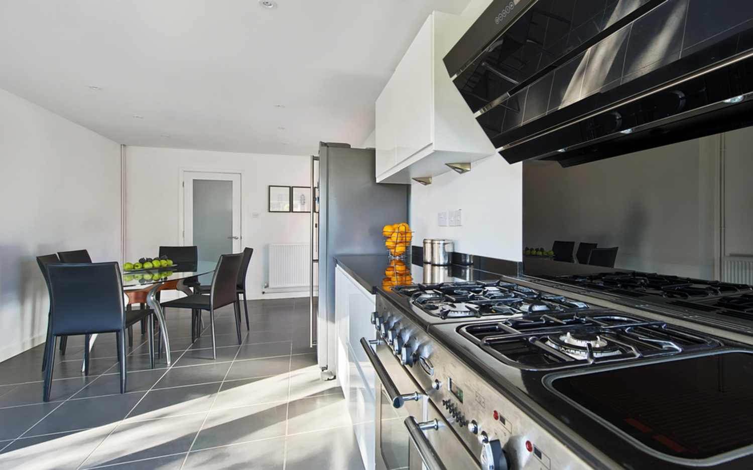 Kitchen appliances worktop of a house extension by Harvey Norman Architects Cambridge