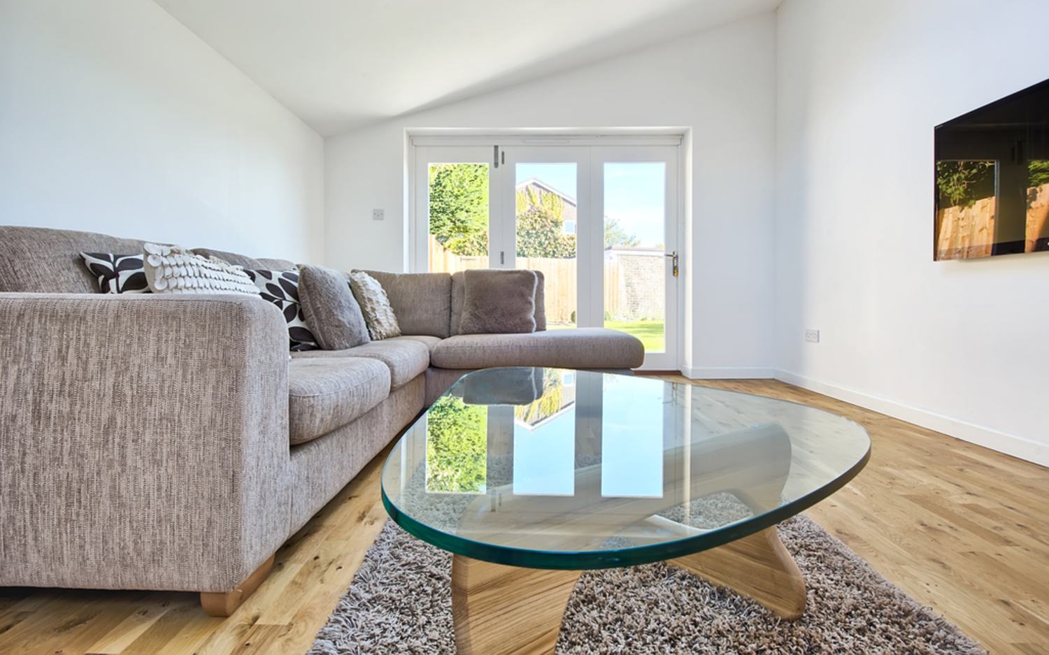 Sitting room coffee table of a house extension by Harvey Norman Architects Cambridge