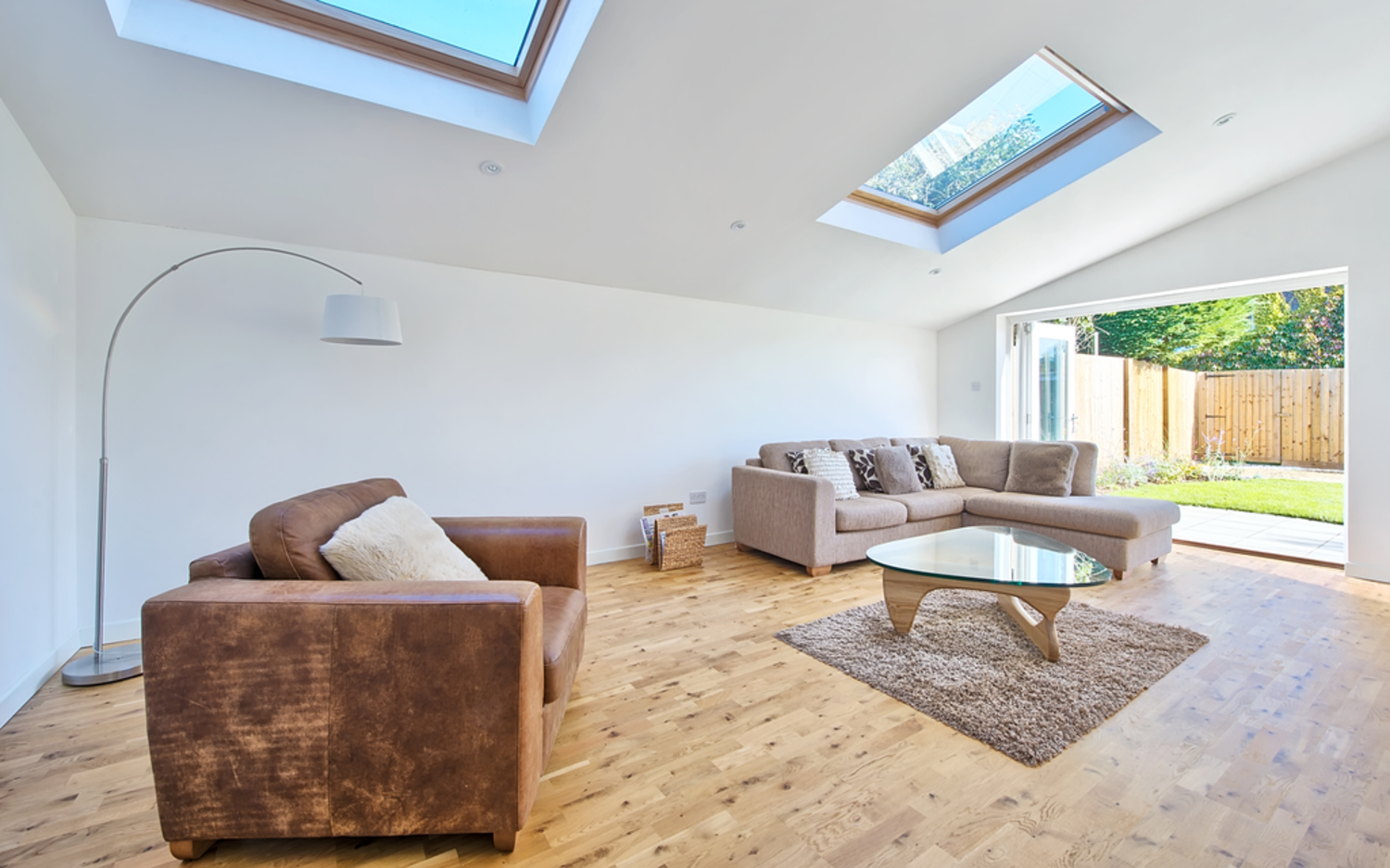 Sitting with lots of natural light of a house extension by Harvey Norman Architects Cambridge