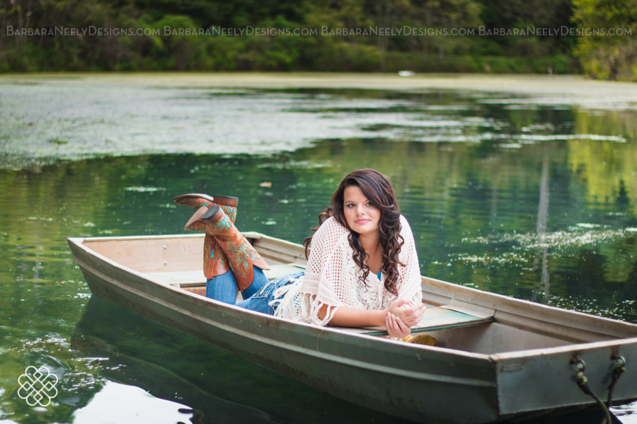 Senior girl in flat bottom boat on the lake
