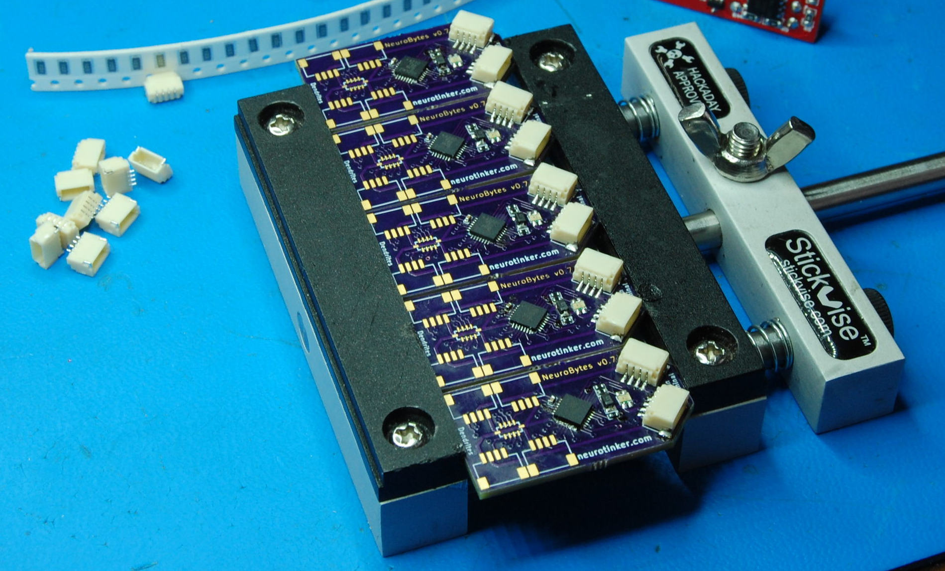 Five v0.7 prototypes midway through soldering, showing the QFN-28 ATtiny88 and single RGB LED.