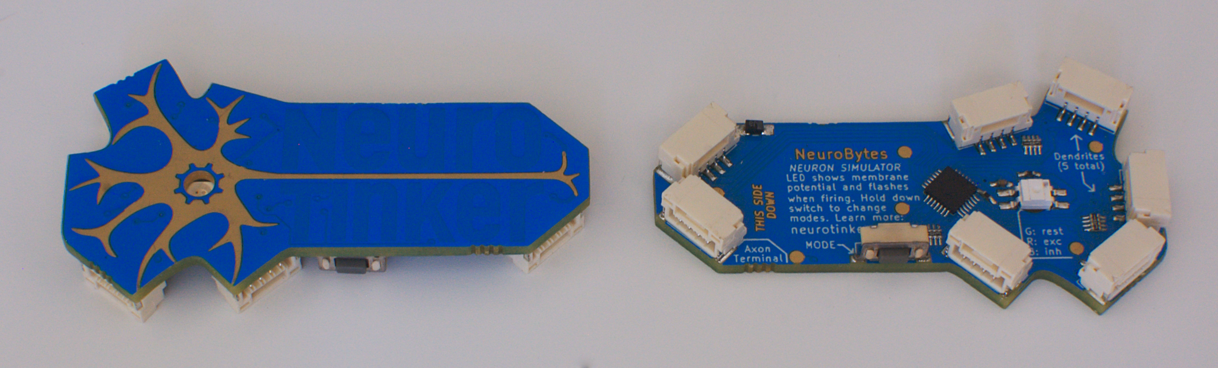 Two v0.8 boards, showing the front and back of the design. Mode switches! Bottom mount LEDs! JST GH connectors! Crazy routed PCB design! So many changes.