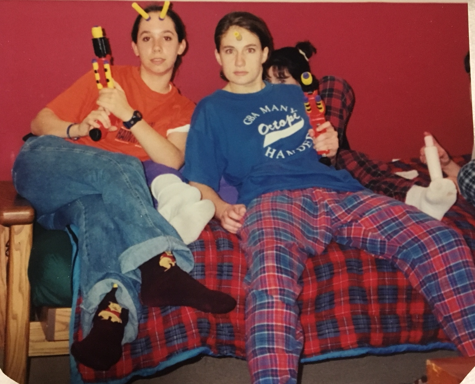 """Along with the hardcore Nerf player vibe we are giving off, take note of the other things that make this photo stunning, including Elizabeth's Winnie-the-Poo socks and my team shirt from the only softball team I've ever played on, """"The Many-Handed Octopi."""""""