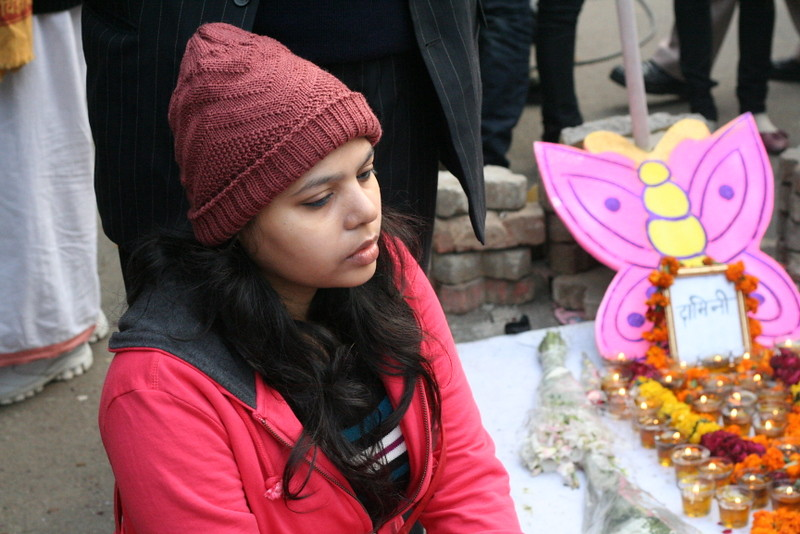 """"""" Protester Posters and Candles seeking Justice for Gang rape Victim-008 """" by   Ramesh Lalwani     is licensed under  CC BY 2.0"""