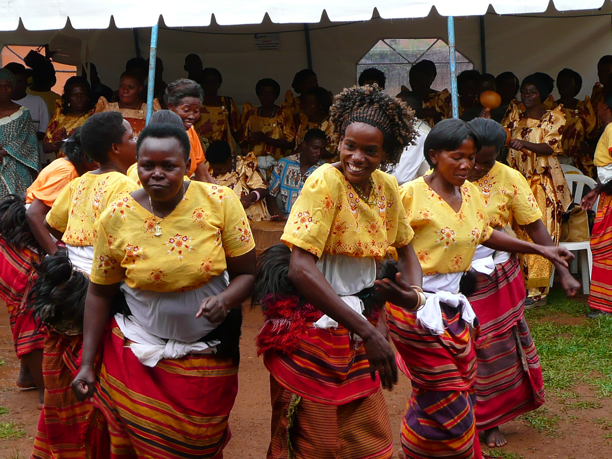 """Photo: """"   Ugandan women celebrate""""    by     Department of Foreign Affairs and Trade         is licensed under    CC BY 2.0"""