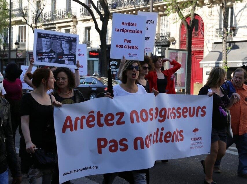 """Photo: """"Stop the repression, not our clients""""/""""Stop our attackers, not our clients"""", photo courtesy of STRASS"""