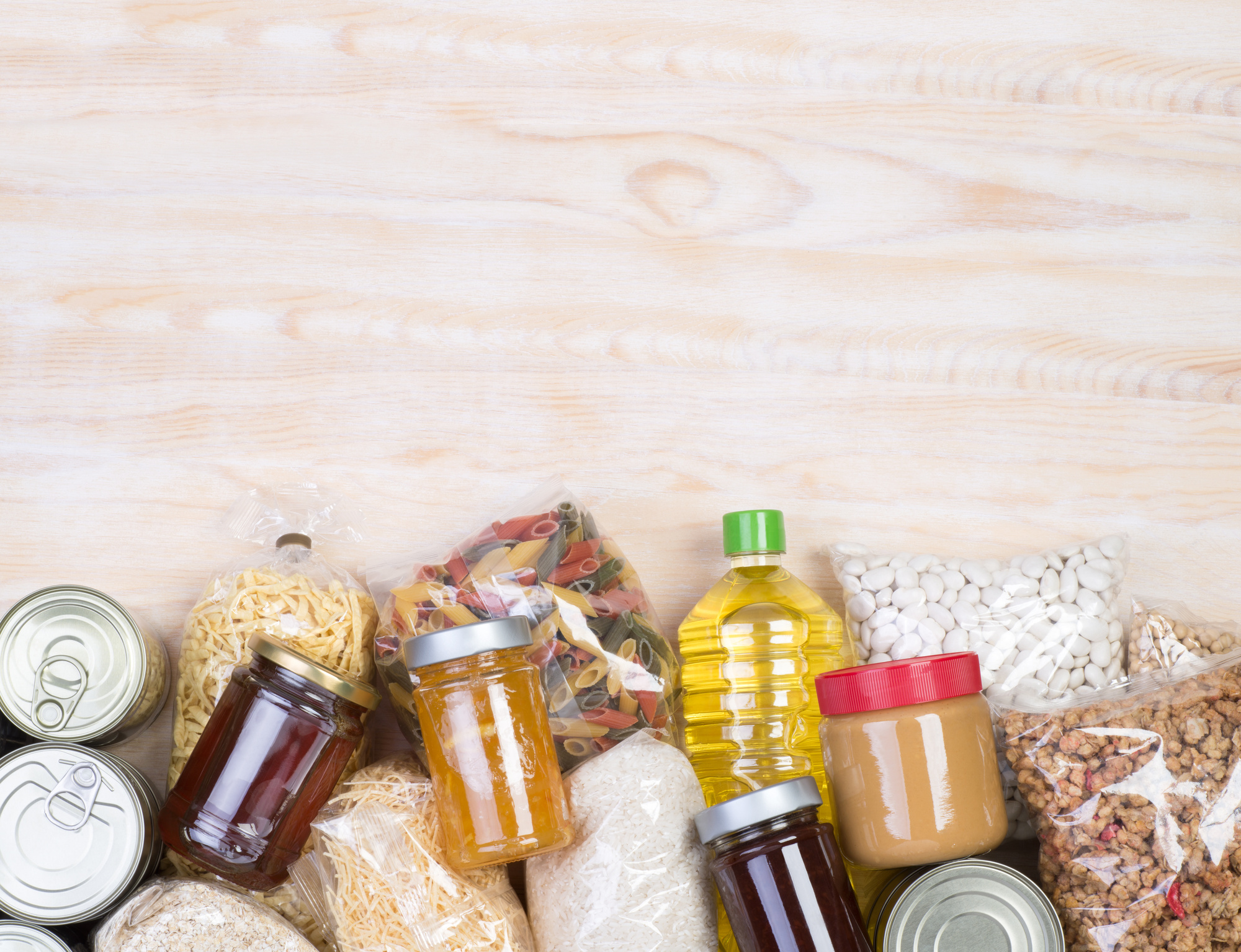 Food donations on wooden background, top view with copy space