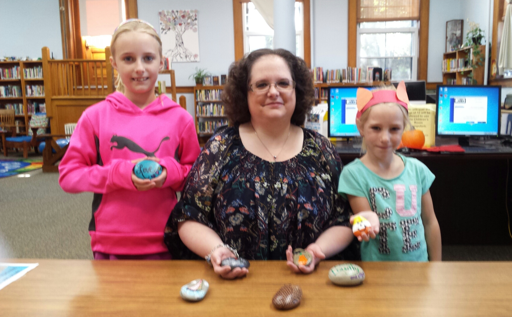Janelle Wallace, center, with two of her Fulton, New York Rock friends.