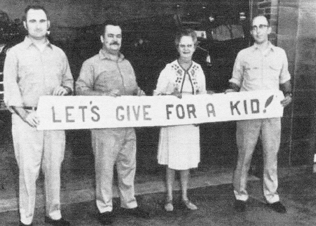 """Fulton firefighters contribute to Clarissa Owens' """"Let's Give For a Kid"""" program during the 1971 Christmas season."""