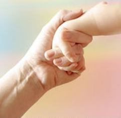 mother-child-hand-mother-holding-childs-hand-on-pastel-colored-background-high-key-stock-photograph_csp0079139.jpg