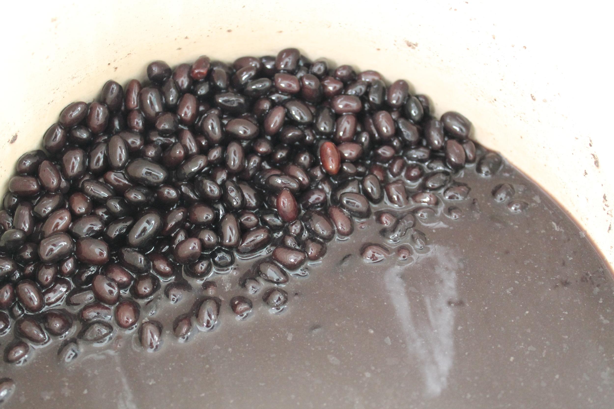 Unstrained par-cooked black beans