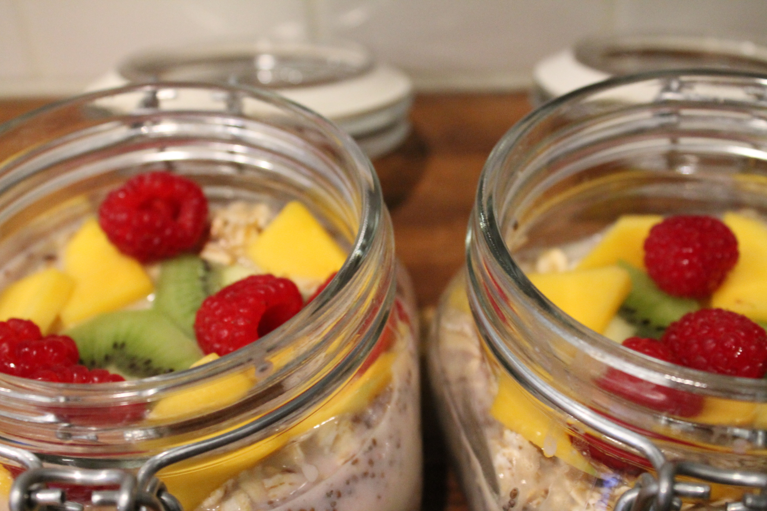 Gluten-free and Vegan Overnight Oats & Chia Seed Parfait with Fresh Fruit. Healthy and satisfying breakfast on the go from www.fernsandpeonies.com Vist the website to download your free guide on living a healthy and compassionate lifestyle!