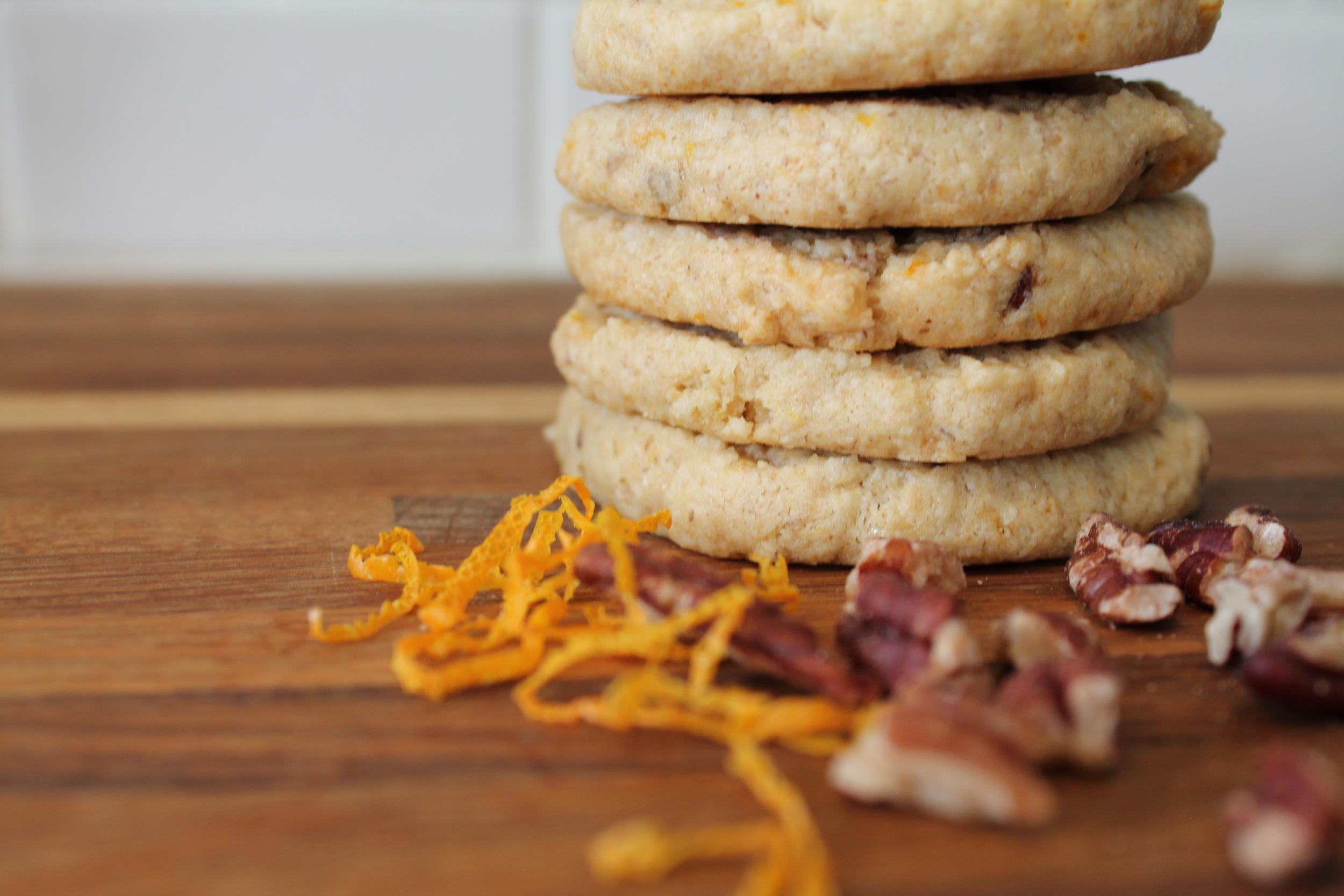 Vegan & Gluten-free Orange Pecan Sandies with Orange Butter-cream Frosting Cookie Sandwich Option. Free recipe on the blog at www.fernsandpeonies.com