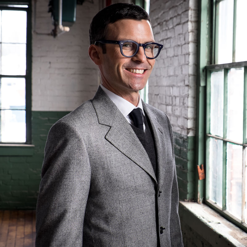 American Woolen Company's CEO, Jacob Harrison Long, in the first ever suit tailored from our fabrics.