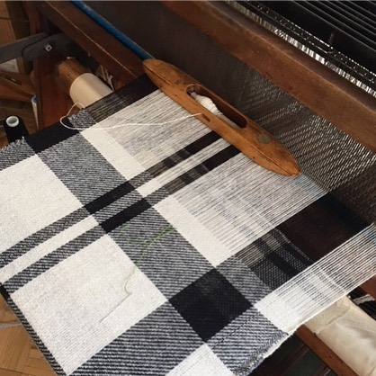 A fabric test by handloom takes about two days to complete but ensures the yarns fit the construction and the pattern and colors are balanced.  #verticalmill #wool #naturalfibers #prototype #blackandwhiteplaid