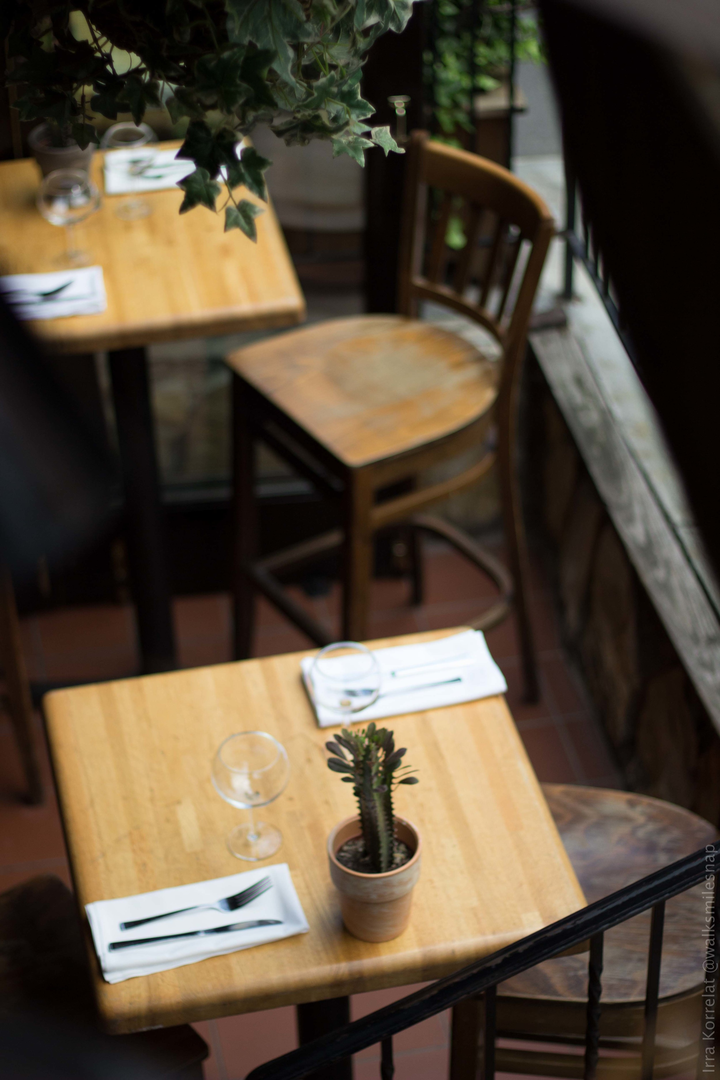 west village cafe restaurant table napkin chair wooden table rustic irra korrelat walksmilesnap.jpg