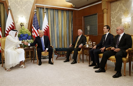 President Donald Trump with Qatar's Emir Sheikh Tamim Bin Hamad Al-Thani in Riyadh on May 21, 2017. From right, national security adviser H.R. McMaster; White House senior adviser Jared Kushner; and Secretary of State Rex Tillerson. Evan Vucci / AP