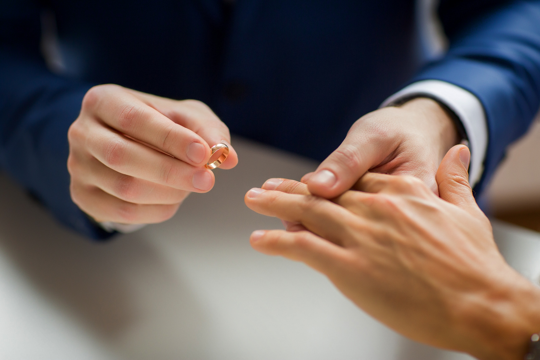 Kansas-LGBT-male-gay-couple-hands-and-wedding-ring.jpg