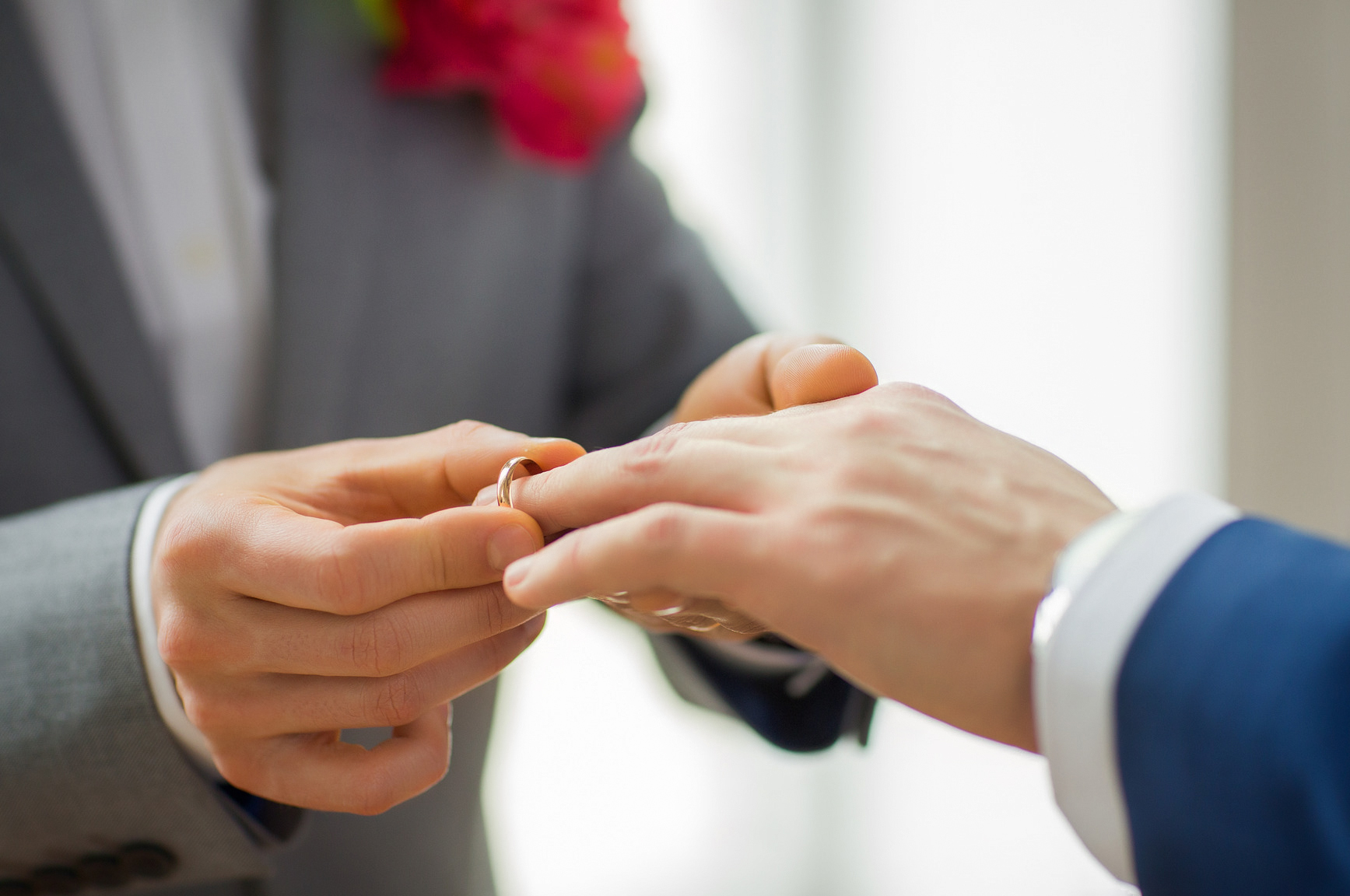 Gay-close-up-of-male-gay-couple-hands-wedding-rings.jpg