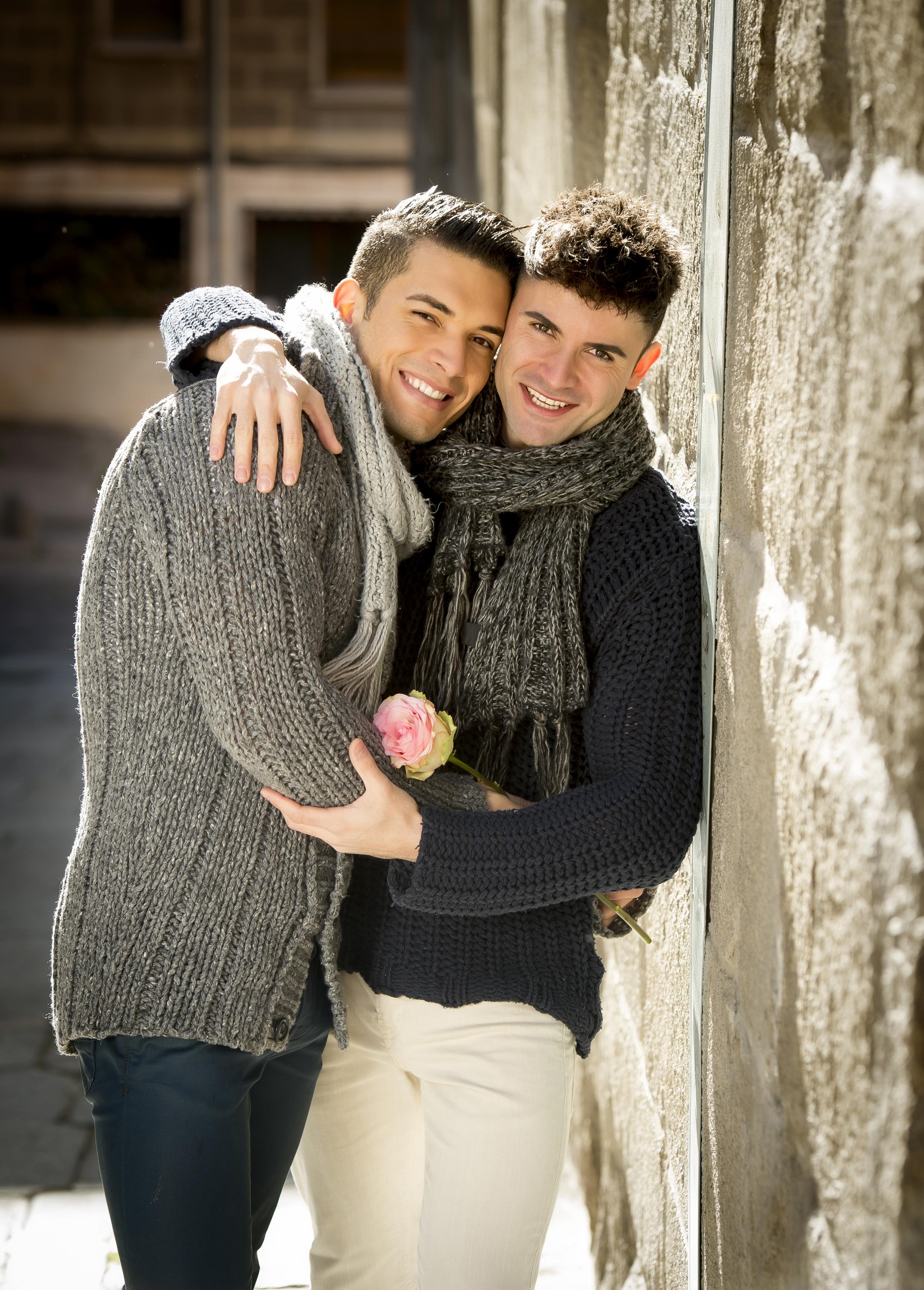 Nancy-Kerr-gay-men-couple-holding-rose-kissing-outdoors-valentines-day.jpg