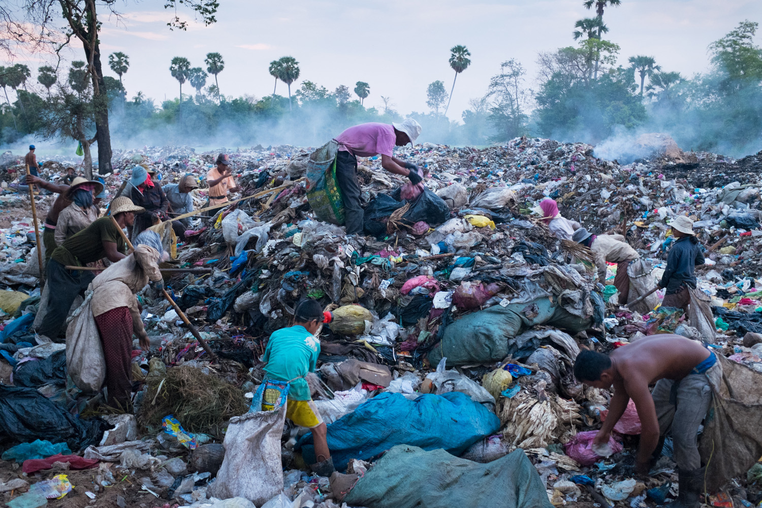 Scavenging atop the massive dump that receives most of the refuse from Siem Reap, Cambodia. Siem Reap is the gateway to the Angkor Archaeological Park, one of Asia's greatest attractions.