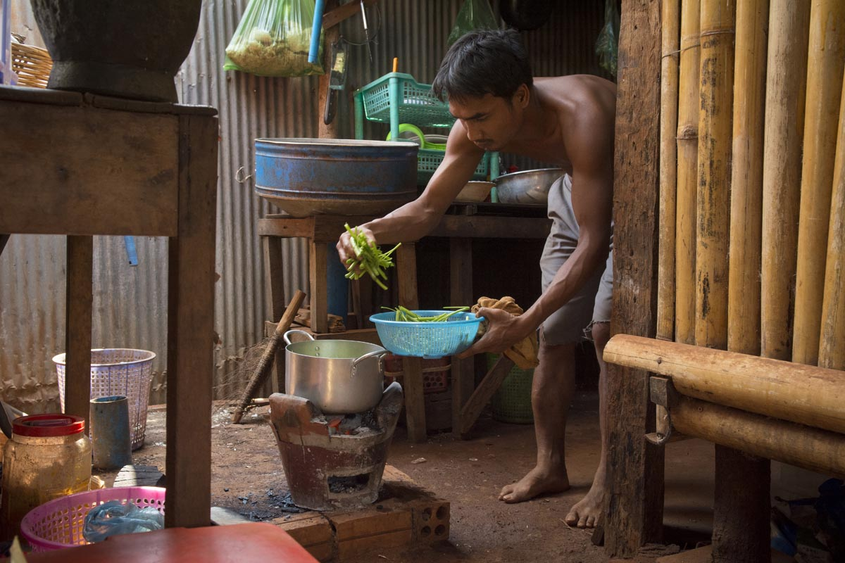 Herm Rithya, also known as Pov, prepares a soup made with prahok, the traditional Khmer fish paste, at his guesthouse in Banlung, Cambodia.