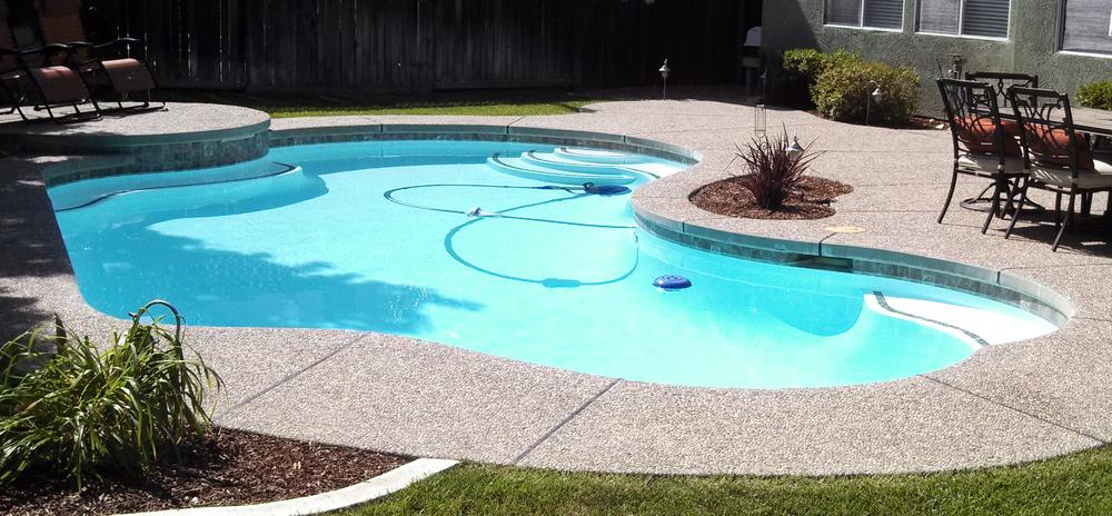 white-fiberglass-pool-resurfacing.jpeg