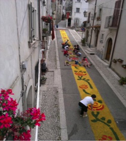 Preparation in occasion of Corpus Domini in June, with flower petals, leaves, coffee grind, and flowers of streets in San Lorenzello.