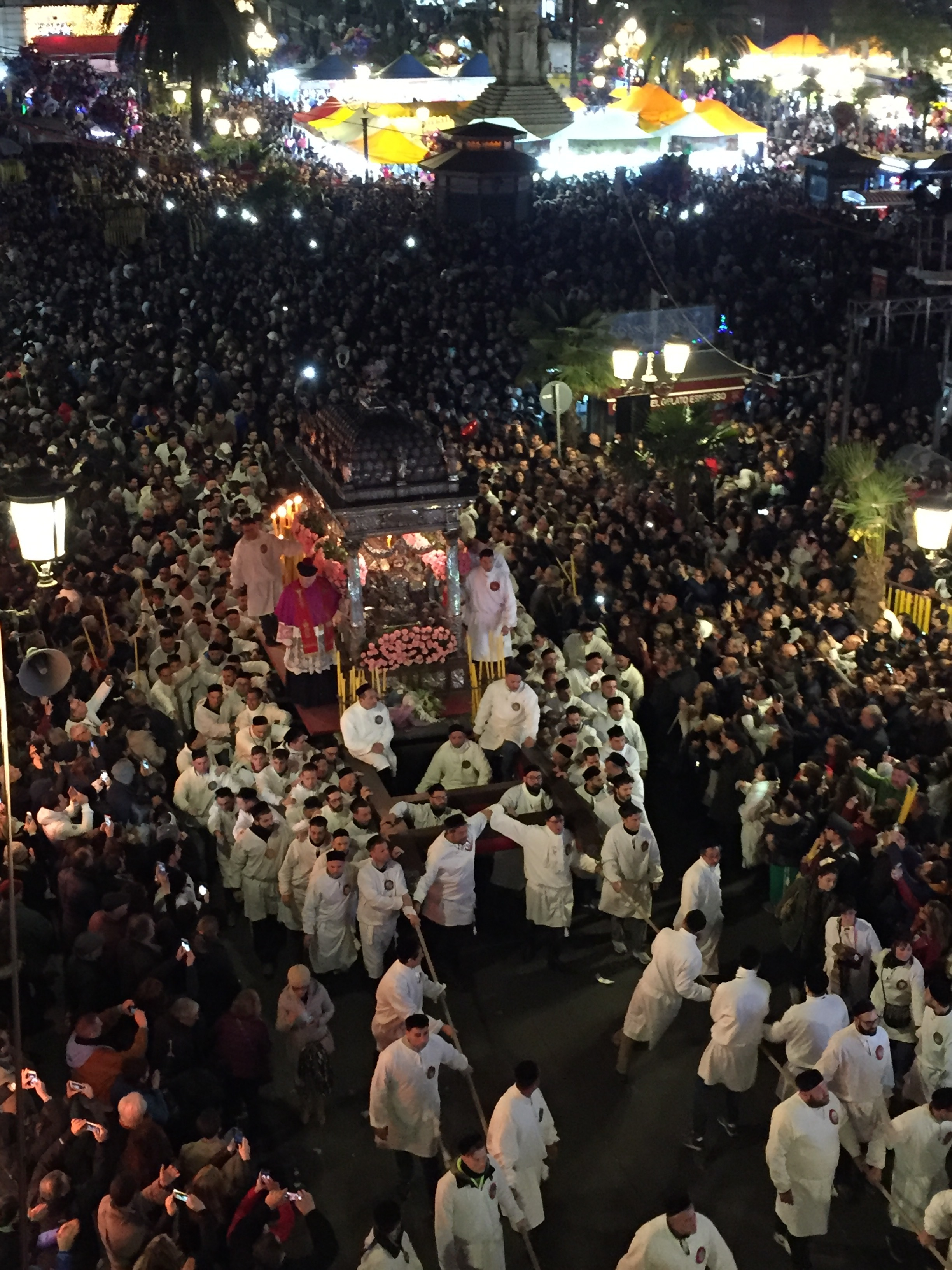 St. Agata in her  vara  (float) being carried by the men in  u saccu  (traditional white robes) worn by her devotees  PICTURE BY TRAVEL ITALIAN STYLE