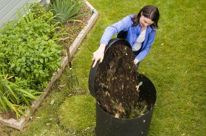 Woman backyard composting